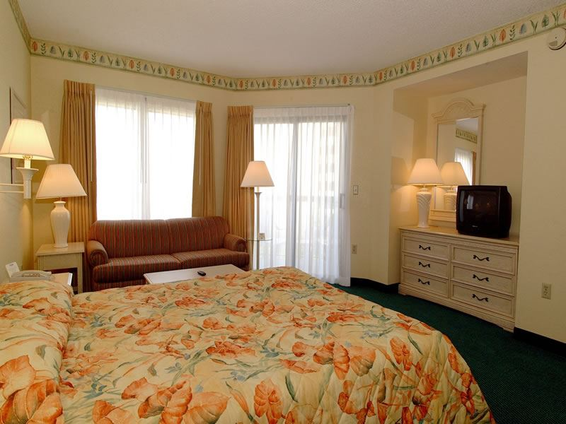 King guestroom at Enclave Suites, Orlando
