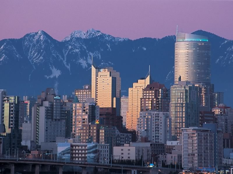 Vancouver skyline against the North Shore Mountains at dusk CR