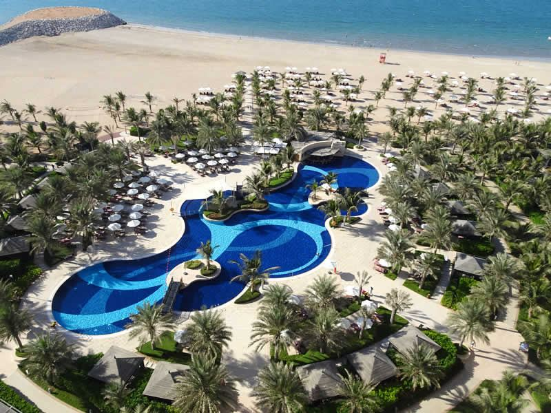 aerial view pool and beach waldorf ras al khaimah