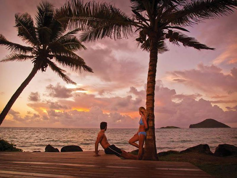 couple admiring the sunset at coconut bay