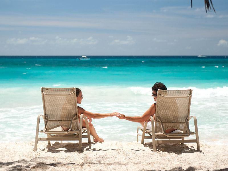 couple lounging on the beach at couples barbados