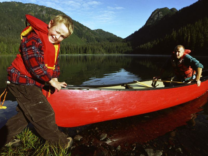father and son with canoe