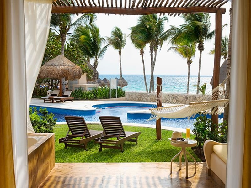 lounge areas by the pool at excellence riviera cancun