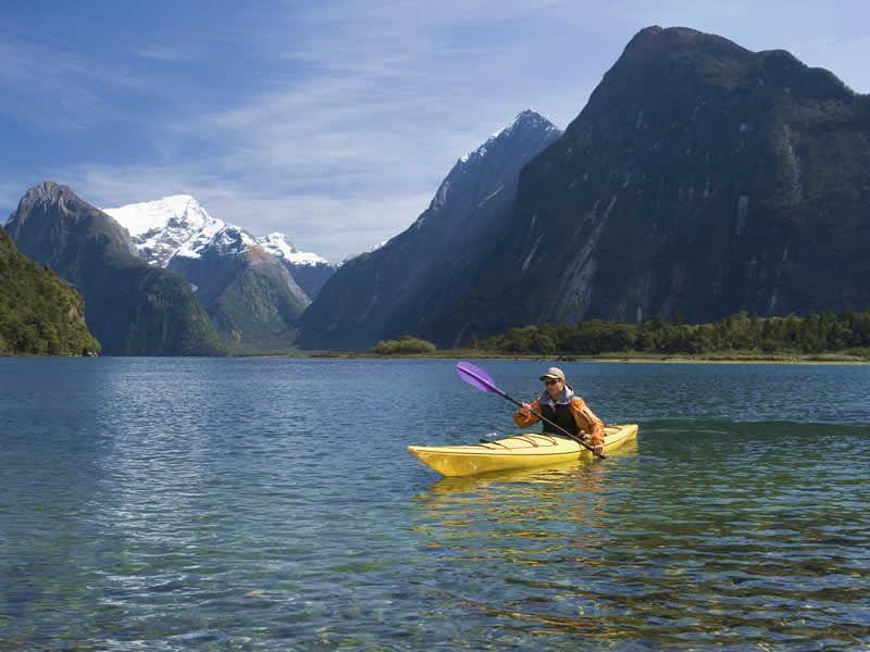 man kayaking in milford sound