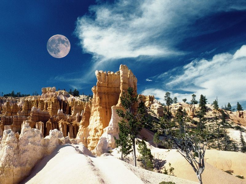 moon over arid landscape bryce canyon national park