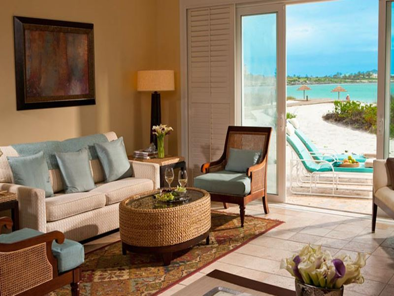 sandals emerald bay prime minister villa suite living room